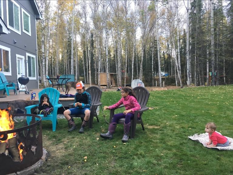 SEPT girls around campfire